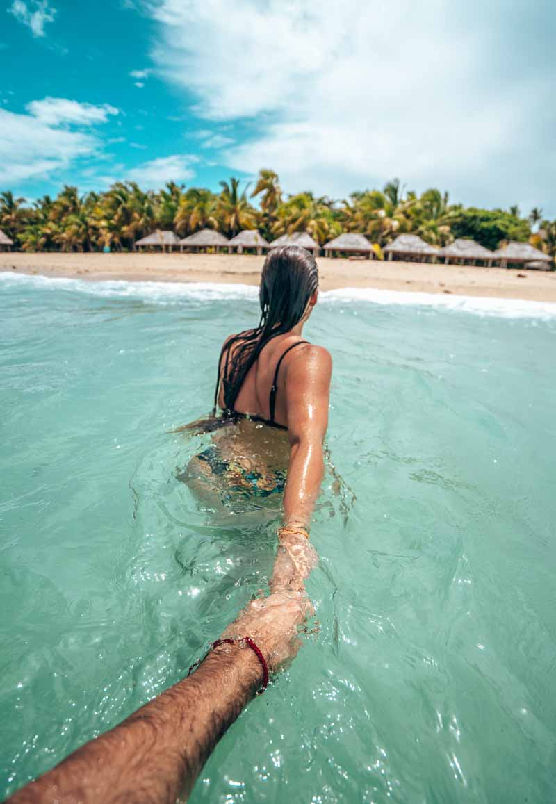 swimming at serenity island resort fiji