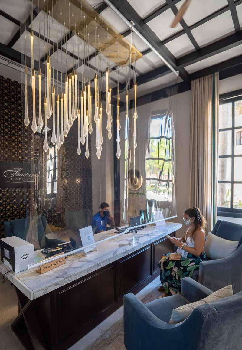 covid check in process in hotels sanctuary cap cana