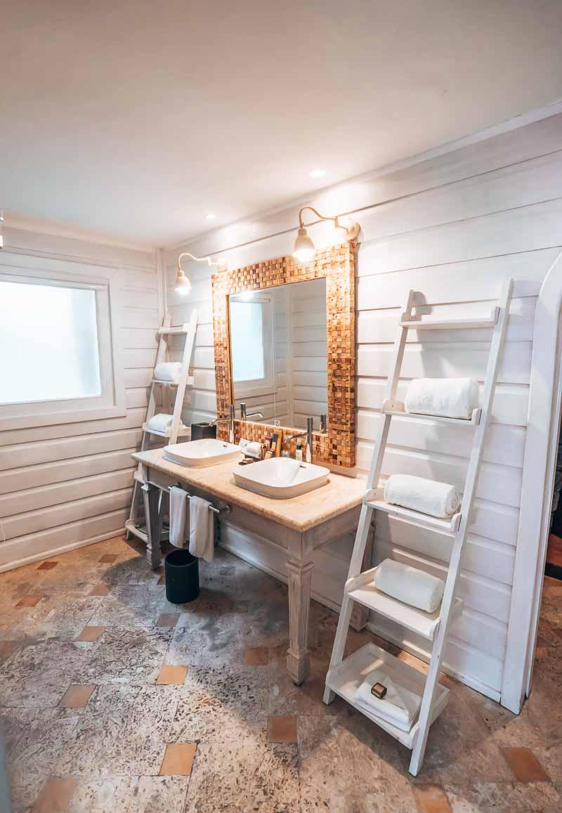 luxury bathroom in hotel suite bungalow
