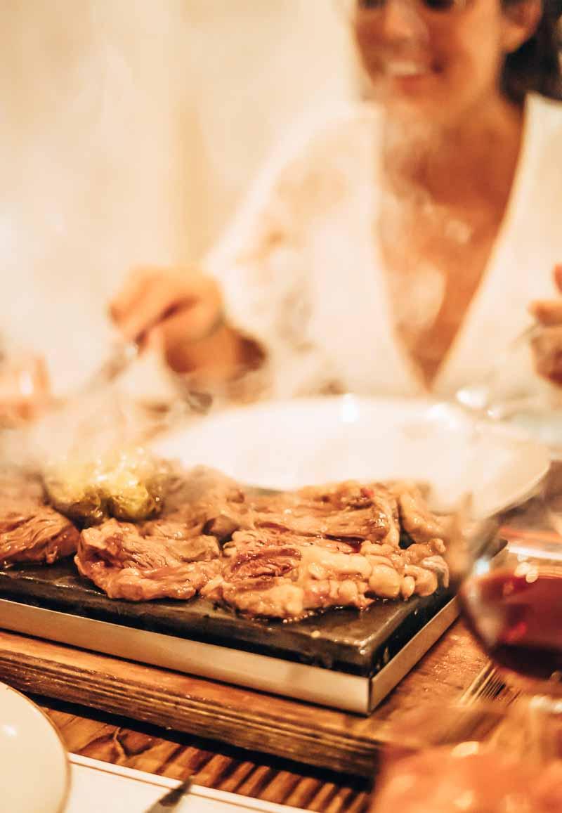 women eating grill platter
