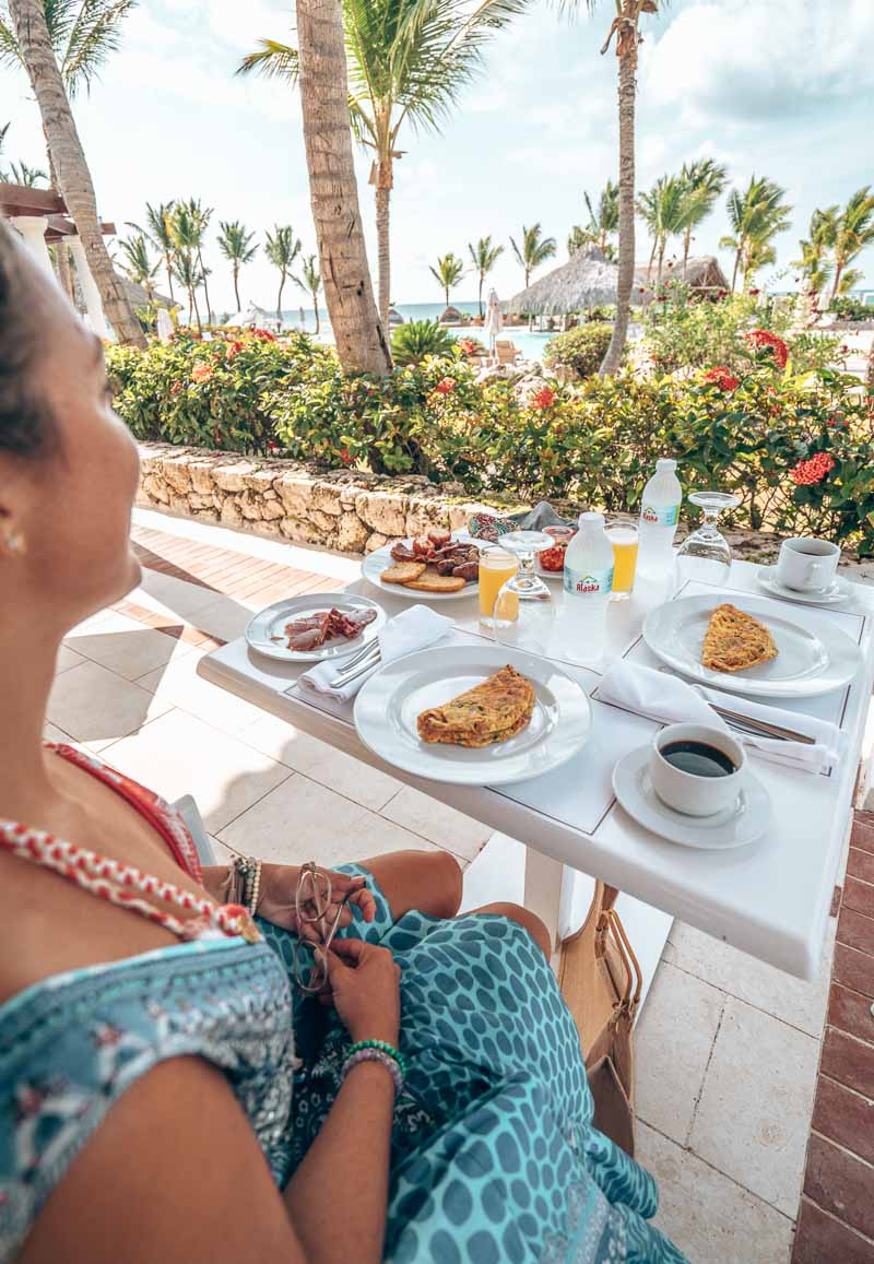 woman eating brunch outdoors
