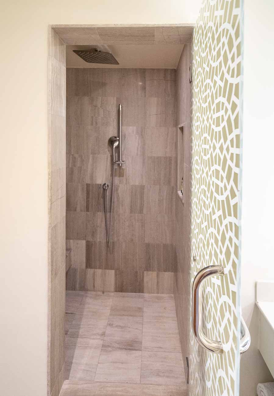 large shower in hotel suite