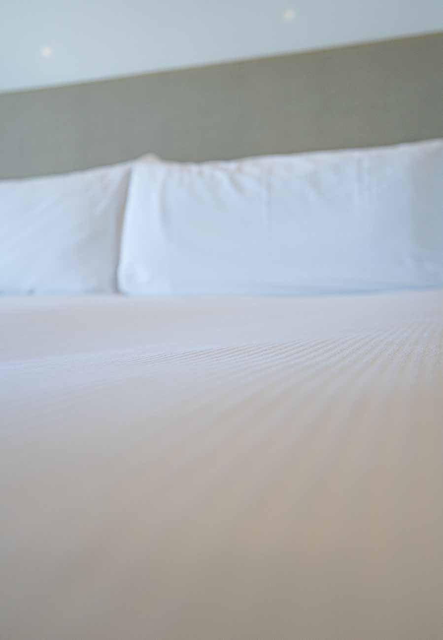 bedding in hotel room