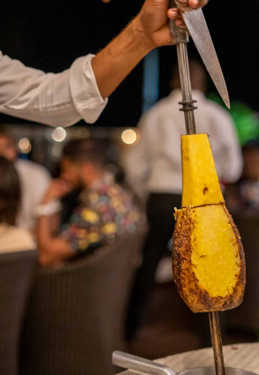 pineapple being cut tableside