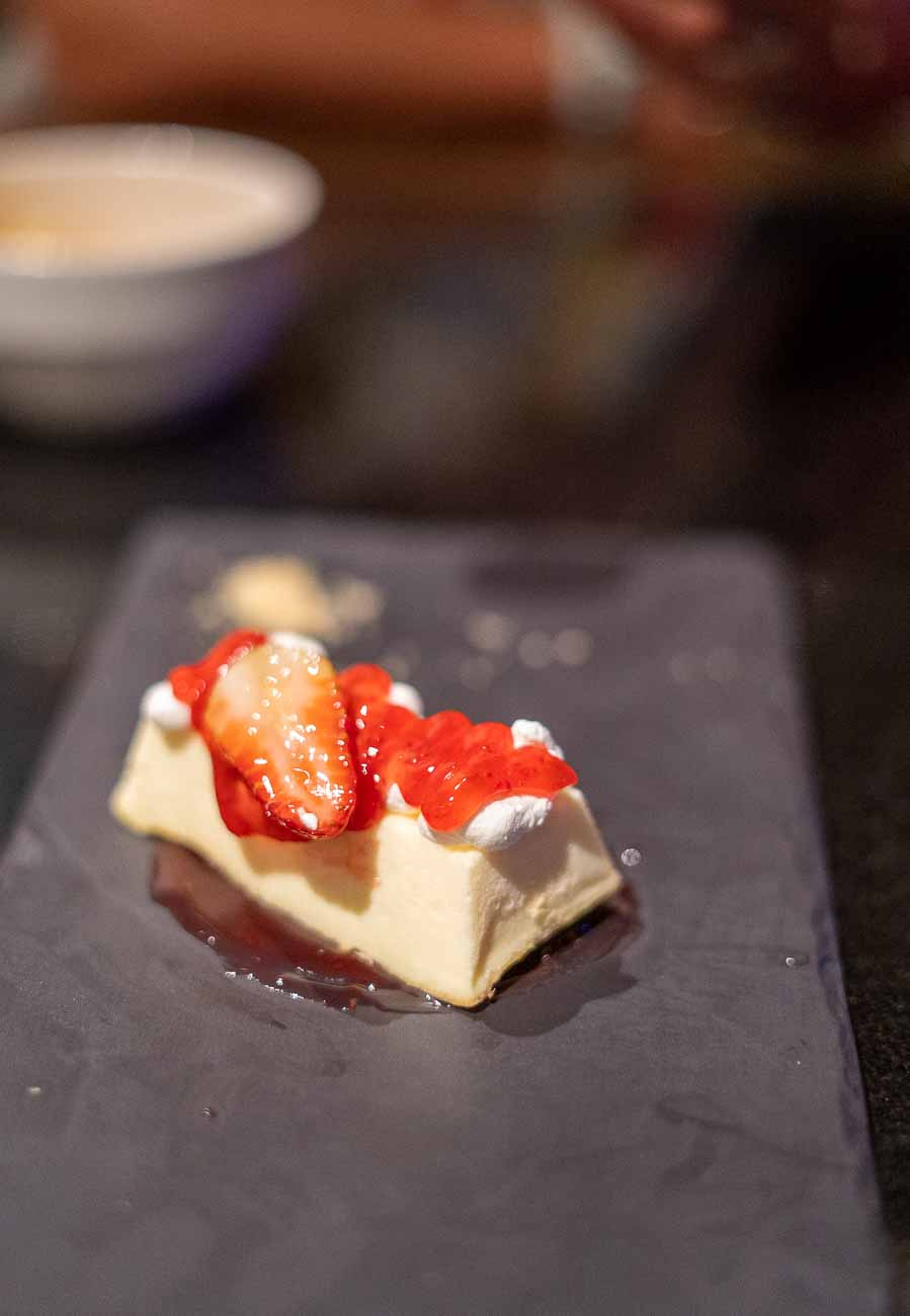 cheesecake plated with strawberry