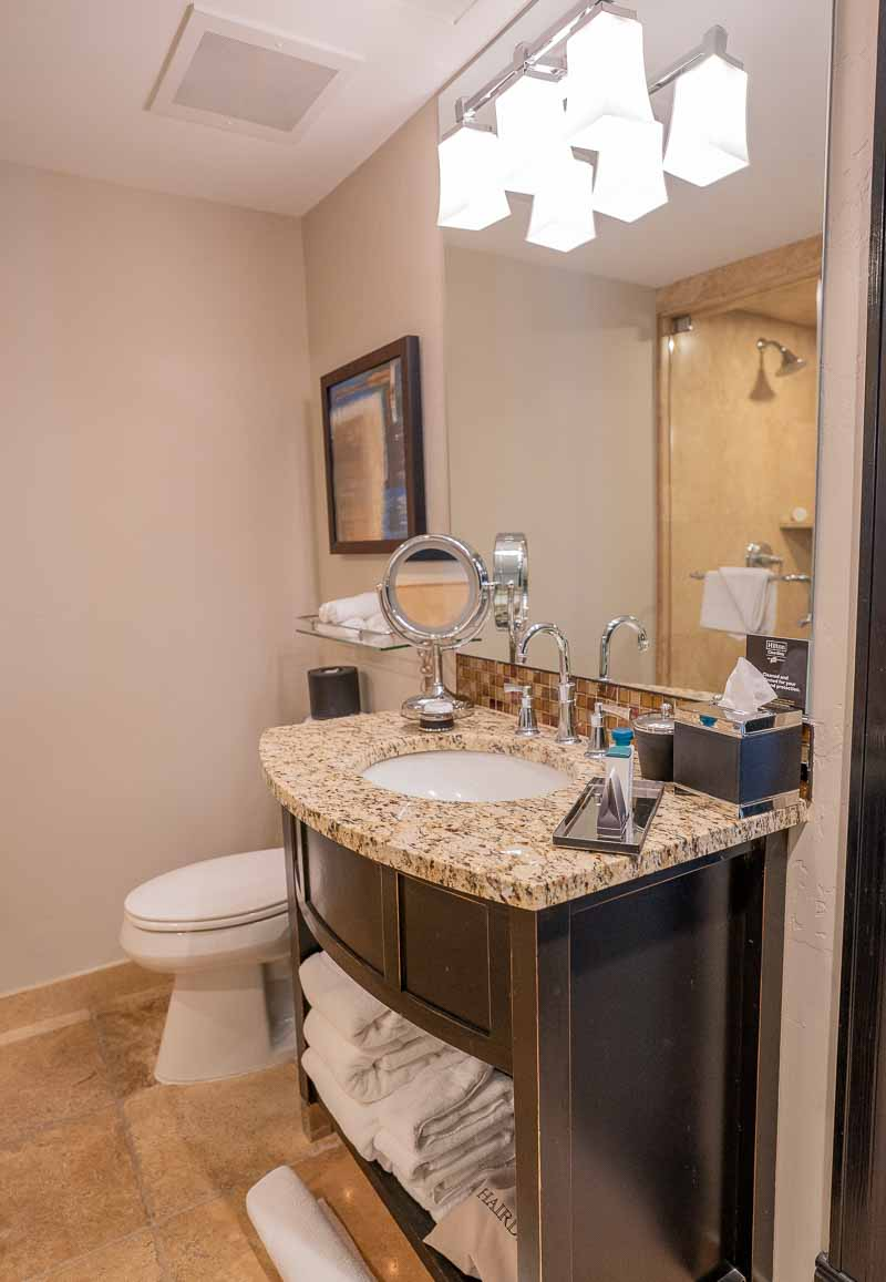 Waldorf Park City king bed suite bathroom