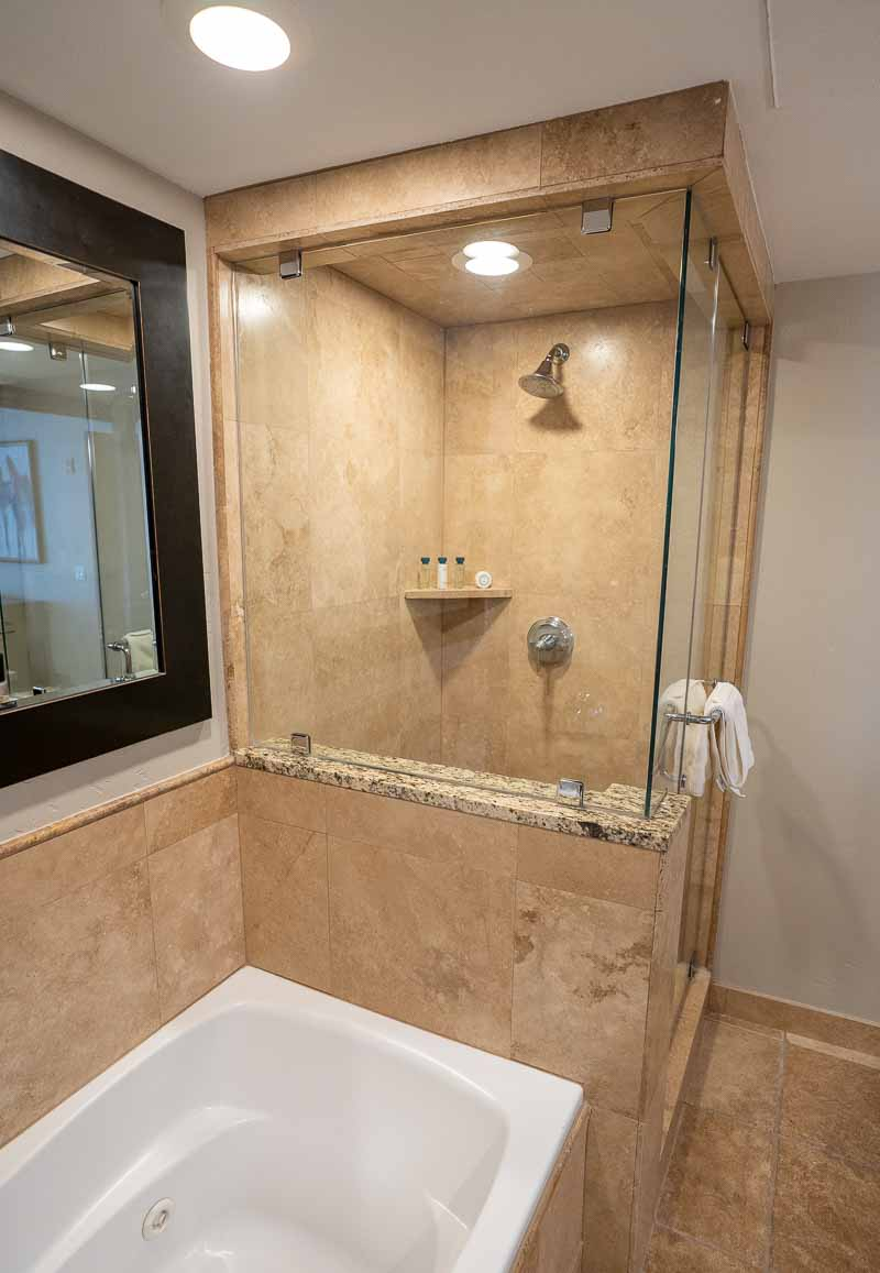 Waldorf Park City king bed suite bathroom shower