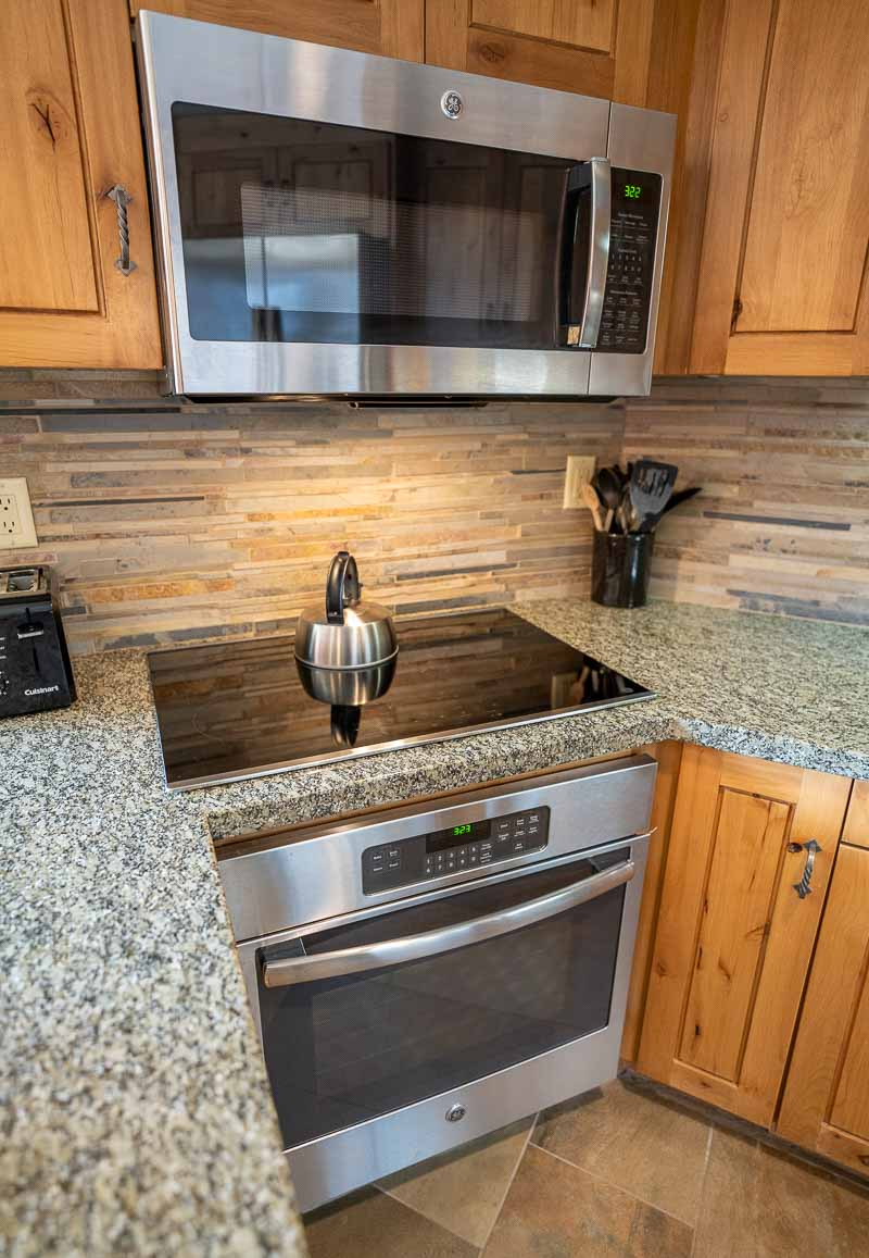 full kitchen with stove and oven grand summit park city