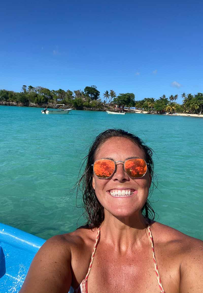 woman smiling on boat selfie